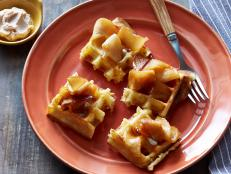 Cooking Channel serves up this Belgian Waffles with Homemade Cinnamon Sugar Butter and Sauteed Cider Apples recipe from Bobby Flay plus many other recipes at CookingChannelTV.com