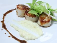 Cooking Channel serves up this Pan Roasted Diver Scallops with Potato and Celery Root Puree and Brown Butter recipe from Michael Symon plus many other recipes at CookingChannelTV.com