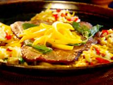 Cooking Channel serves up this Fast Fry Steak with Sundried Tomato and Roasted Red Pepper Orzo and Mango Salad recipe from Roger Mooking plus many other recipes at CookingChannelTV.com