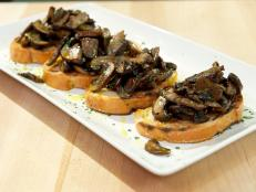 Cooking Channel serves up this Bruschetta with Sauteed Mushrooms recipe from Debi Mazar and Gabriele Corcos plus many other recipes at CookingChannelTV.com