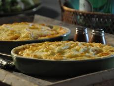 Cooking Channel serves up this Fisherman's Pie with Potato Gratin recipe from Roger Mooking plus many other recipes at CookingChannelTV.com