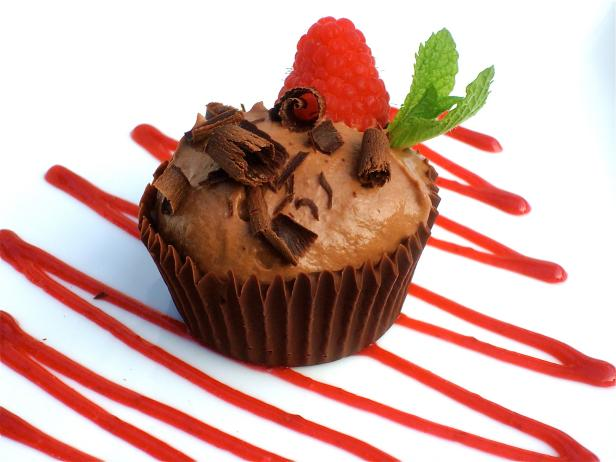 Chocolate Mousse served in Edible Chocolate Dessert Cups with Raspberry Sauce