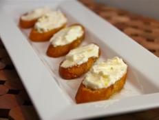 Cooking Channel serves up this Three Cheese Crostini with Honey recipe from Kelsey Nixon plus many other recipes at CookingChannelTV.com