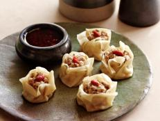 "Cooking Channel serves up this Steamed Pork and Mushroom ""Siu Mai"" Dumplings recipe from Ching-He Huang plus many other recipes at CookingChannelTV.com"