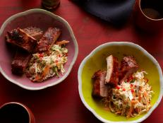 Cooking Channel serves up this Spicy Soy Ribs with Sweet and Sour Slaw recipe from Ching-He Huang plus many other recipes at CookingChannelTV.com