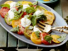 Cooking Channel serves up this Heirloom Tomato Caprese Salad recipe from Debi Mazar and Gabriele Corcos plus many other recipes at CookingChannelTV.com