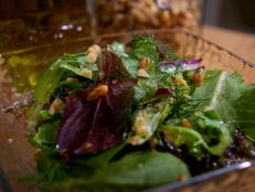 Cooking Channel serves up this Mixed Greens with Walnut Vinaigrette recipe from Laura Calder plus many other recipes at CookingChannelTV.com