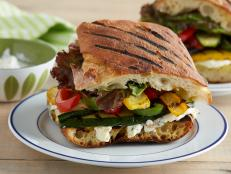 Cooking Channel serves up this Grilled Vegetable Panini with Herbed Feta Spread recipe from Kelsey Nixon plus many other recipes at CookingChannelTV.com