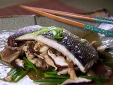 Cooking Channel serves up this Steamed Sea Bass with Ginger and Chinese Mushrooms recipe from Ching-He Huang plus many other recipes at CookingChannelTV.com