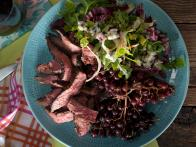 Broiled Flank Steak with Grilled Champagne Grapes and a Bitter Greens and Blue Cheese Salad