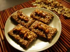 Cooking Channel serves up this Coconut Almond Date Granola Bars recipe  plus many other recipes at CookingChannelTV.com