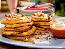 Cooking Channel serves up this Carrot Cake Pancakes with Maple-Cream Cheese Drizzle and Toasted Pecans recipe from Bobby Flay plus many other recipes at CookingChannelTV.com