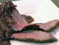 Cooking Channel serves up this Grilled Flank Steak with Shallot and Red Wine Sauce recipe  plus many other recipes at CookingChannelTV.com