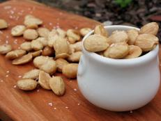 Cooking Channel serves up this Olive Oil Poached Marcona Almonds recipe from Josh Kilmer-Purcell  and Brent Ridge plus many other recipes at CookingChannelTV.com