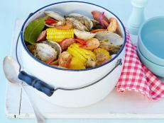 "Cooking Channel serves up this ""Cleveland Style"" Clambake recipe from Michael Symon plus many other recipes at CookingChannelTV.com"