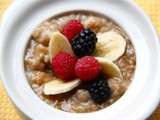 Cooking Channel serves up this Slow Cooker Irish Oatmeal with Bananas and Berries recipe from Kelsey Nixon plus many other recipes at CookingChannelTV.com