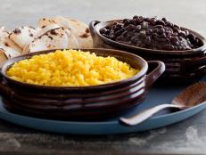 Cooking Channel serves up this Spicy Black Beans and Yellow Rice recipe from Tyler Florence plus many other recipes at CookingChannelTV.com