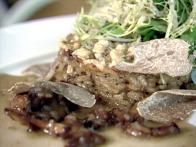 Mushroom Risotto Cakes Stuffed with Duck Liver, Petit Greens, and White Truffles