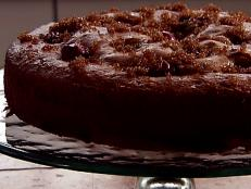 Cooking Channel serves up this Olive Oil and Red Grape Cake recipe from Laura Calder plus many other recipes at CookingChannelTV.com