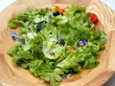 Cooking Channel serves up this Salad with Nasturtiums and Raspberry Vinaigrette recipe from Laura Calder plus many other recipes at CookingChannelTV.com