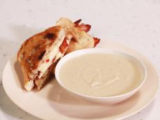Cooking Channel serves up this Creamy Apple and Celery Root Soup with Grilled Cheddar, Bacon and Apple Honey Mustard Sandwich recipe from Rachael Ray plus many other recipes at CookingChannelTV.com