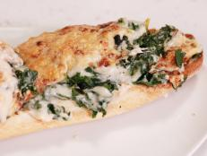 Cooking Channel serves up this Swiss Chard au Gratin French Bread Pizzas recipe from Rachael Ray plus many other recipes at CookingChannelTV.com