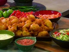 Cooking Channel serves up this Salt Cod Fritters with Creamy Mustard Sauce, Spicy Orange Chili Sauce, Pineapple Chutney and Shredded Zucchini Salad recipe from Roger Mooking plus many other recipes at CookingChannelTV.com