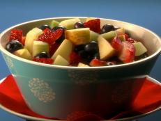 Cooking Channel serves up this Ginormous Fruit Salad Surprise recipe from Lisa Lillien plus many other recipes at CookingChannelTV.com