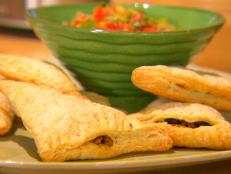 Cooking Channel serves up this Chicken and Bean Puff Pastry Empanadas recipe from Dave Lieberman plus many other recipes at CookingChannelTV.com