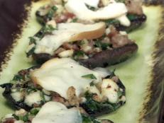 Cooking Channel serves up this Portobello Stuffed with Sausage, Spinach and Smoked Mozzarella recipe from Bobby Flay plus many other recipes at CookingChannelTV.com