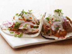 Cooking Channel serves up this Fish Tacos recipe from Bobby Flay plus many other recipes at CookingChannelTV.com