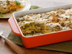 Cooking Channel serves up this Roast Chicken Enchilada Suizas Stacked Casserole recipe from Rachael Ray plus many other recipes at CookingChannelTV.com