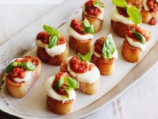 Cooking Channel serves up this Tomato, Mozzarella and Basil Bruschetta recipe from Giada De Laurentiis plus many other recipes at CookingChannelTV.com