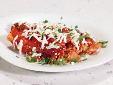 Cooking Channel serves up this Chicken Enchiladas recipe from Rachael Ray plus many other recipes at CookingChannelTV.com