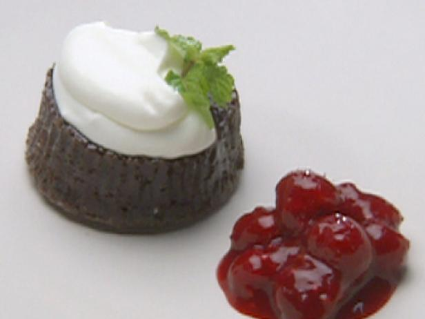 Warm Chocolate Gateaux Topped with Sour Cream Quenelle and Raspberry Sauce