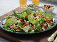 CCTIA106_Grilled-Shrimp-Salad-with-Goat-Cheese-Avocado-and-Black-Olives-recipe_s4x3