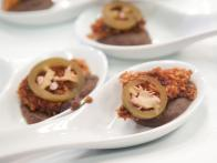 Crispy Fried Kellogg's® Crispix® Ham with Black Bean Puree and Pickled Jalapenos
