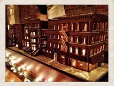 Brooklyn-based blogger Renee Bauman has taken the classic gingerbread house to an awesome new level. She, along with some amateur baker volunteers, has built an entire illuminated gingerbread block of brownstones -- complete with fire escapes and candy glass.