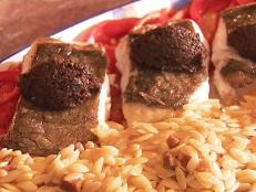 Cooking Channel serves up this Oven-Roasted Halibut with Black Olive Tapenade on Roasted Red Peppers (Rape Asado con Tapenada Negra Y Pimientos Morrones) recipe from Daisy Martinez plus many other recipes at CookingChannelTV.com