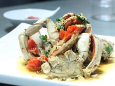 Cooking Channel serves up this Whole Roasted Dungeness Crab, Mint, Parsley and Oven-Roasted Tomatoes recipe from Michael Symon plus many other recipes at CookingChannelTV.com