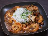 louisiana style shrimp is cooked in creole sauce