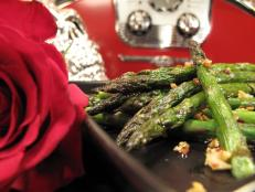 Cooking Channel serves up this Spicy Sauteed Asparagus with Tamari and Toasted Garlic recipe from Nadia G. plus many other recipes at CookingChannelTV.com