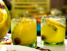 Cooking Channel serves up this Tropical Sangria recipe from Bobby Flay plus many other recipes at CookingChannelTV.com