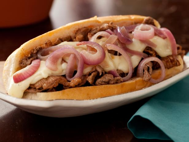 Philly Cheesesteaks with Melted Fontina and Sauteed Red Onions