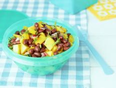 Cooking Channel serves up this Black Bean Salad with Mango, Cilantro and Lime recipe from Kelsey Nixon plus many other recipes at CookingChannelTV.com