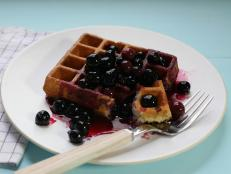 Cooking Channel serves up this Corn Waffles with Blueberry Syrup recipe  plus many other recipes at CookingChannelTV.com