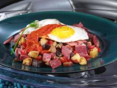 Cooking Channel serves up this Montreal Smoked Meat Hash with Chile Sauce recipe from Nadia G. plus many other recipes at CookingChannelTV.com