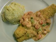Fried Catfish topped with Crawfish Au Gratin Sauce