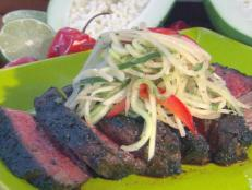 Cooking Channel serves up this Jerk Rubbed Rib-Eye with Green Papaya Relish recipe from Bobby Flay plus many other recipes at CookingChannelTV.com