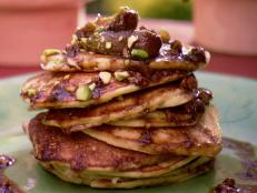 Cooking Channel serves up this Orange Ricotta Pancakes with Caramelized Fig and Pistachio Compote recipe from Bobby Flay plus many other recipes at CookingChannelTV.com